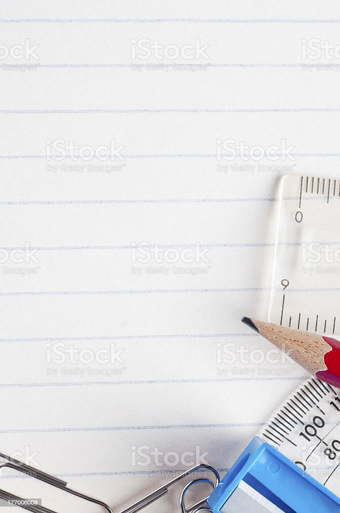 Stationery on Lined Paper Background royalty-free stock photo