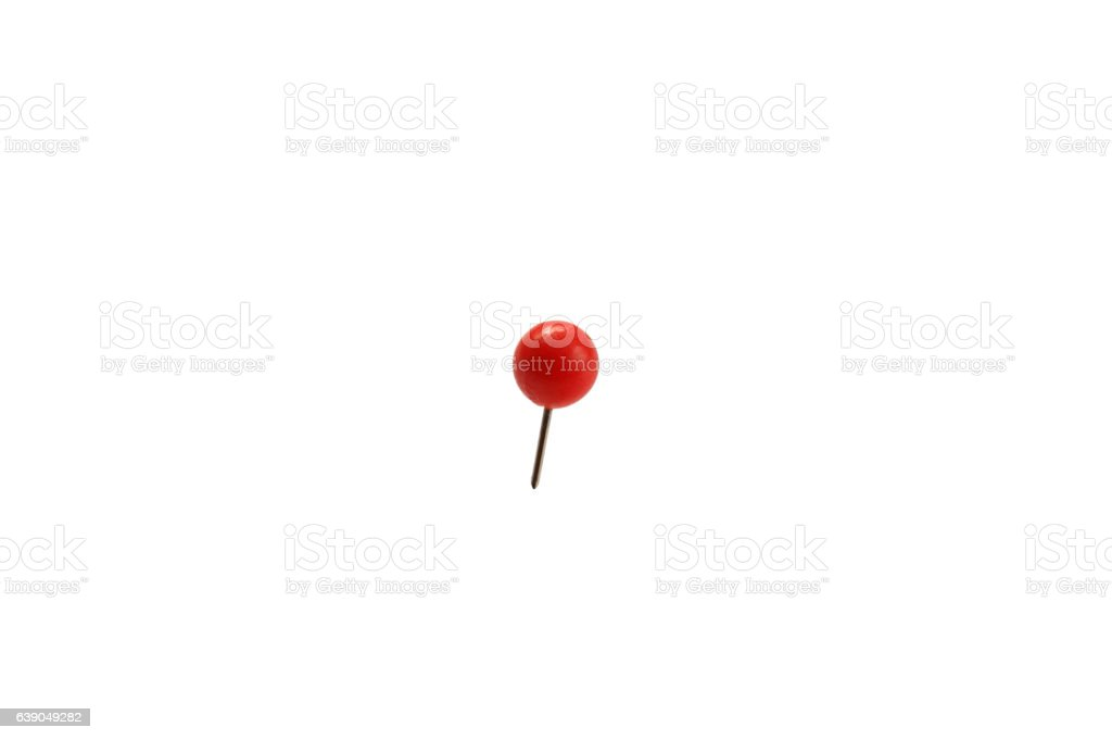 stationery small pin with a ball stuck in a white background stock photo