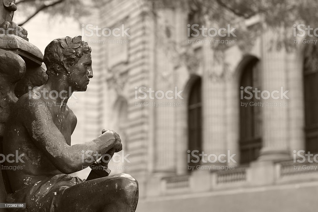Statuary with Building Background stock photo