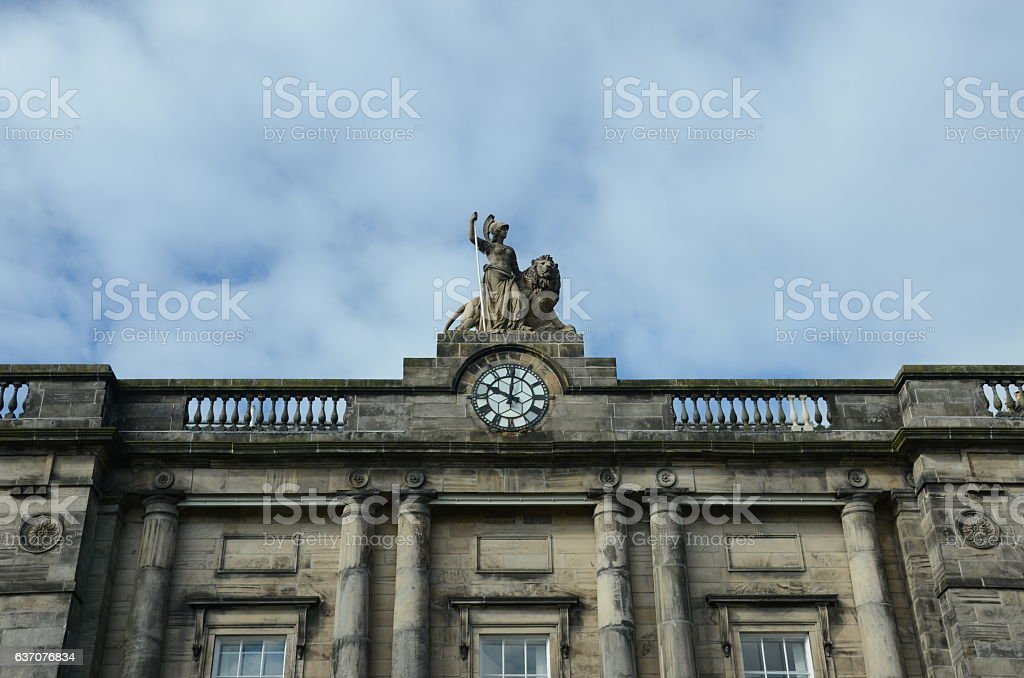 Statue and Clock stock photo
