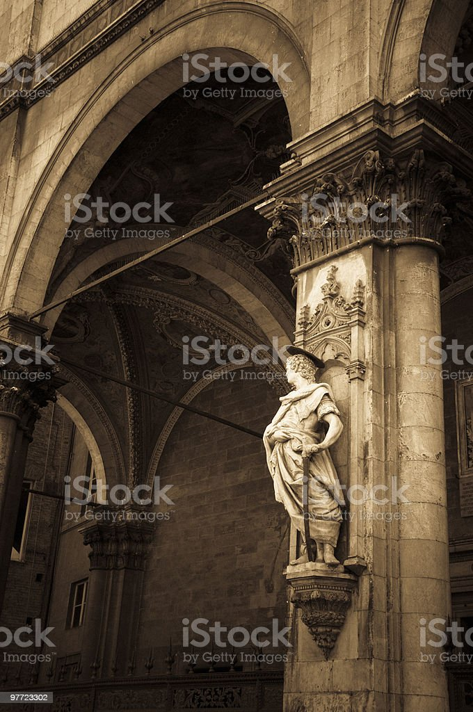 Statue and column in the historic center of Siena royalty-free stock photo