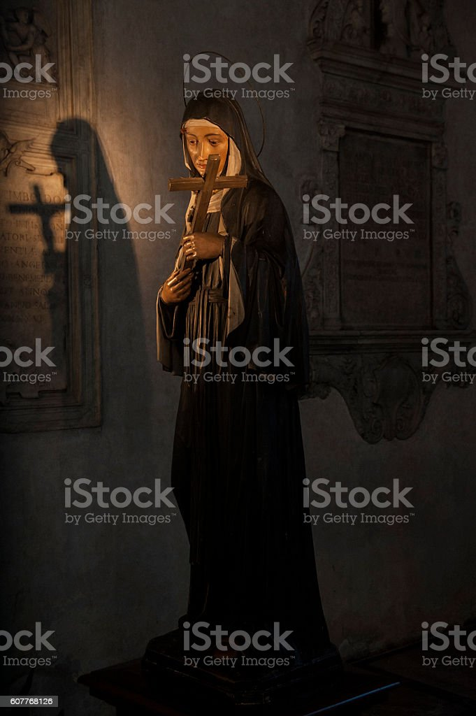 Statue and shadow of the Virgin Mary stock photo