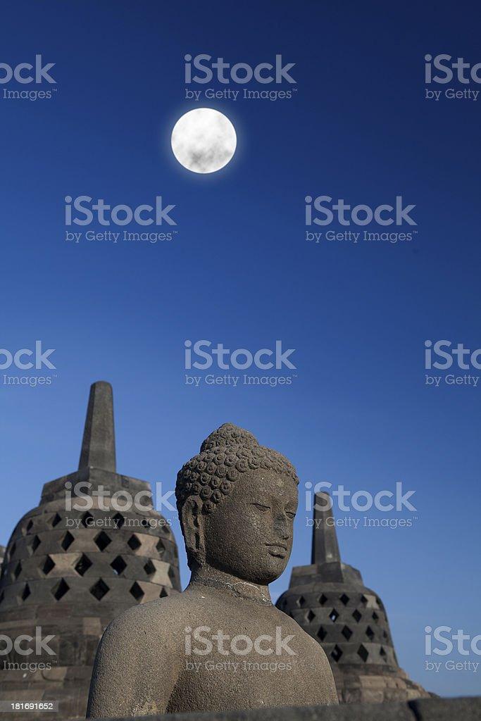 Statue and stupa at borobudur 1 royalty-free stock photo