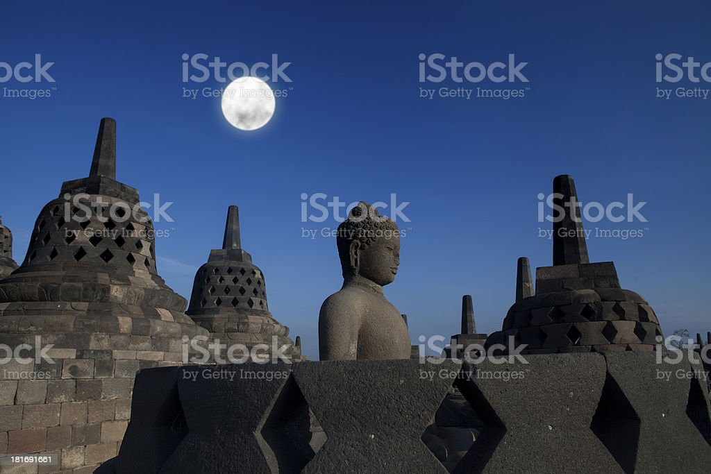 Statue and stupa at borobudur royalty-free stock photo