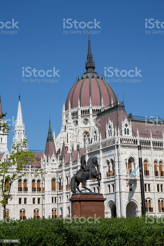 Statue and the dome of the Hungarian Parliament in Budapest stock photo