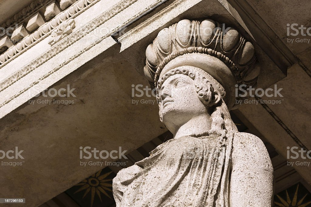 Statue at base of Friedensengel in Munich, Germany royalty-free stock photo