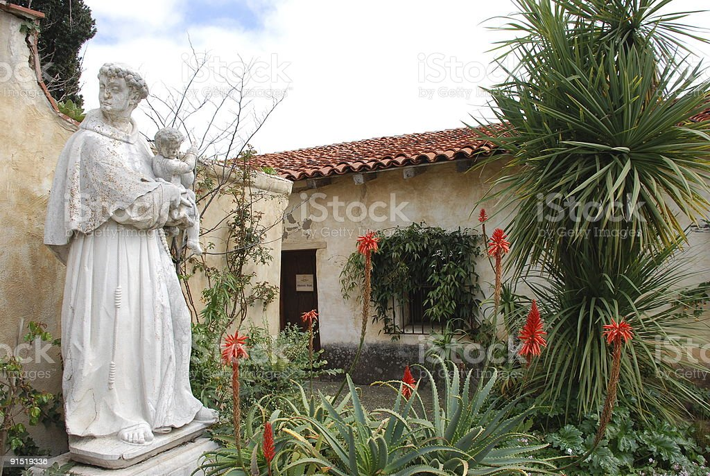 statue at carmel mission stock photo