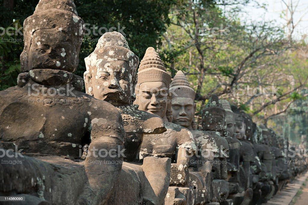 Statue at the entrance of Angkor Thom, Cambodia royalty-free stock photo