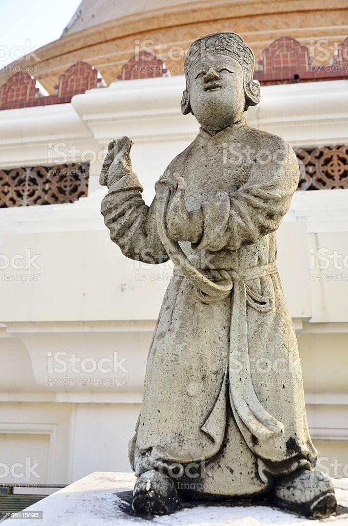 Statue chinese doll at Phra Pathom Chedi stock photo