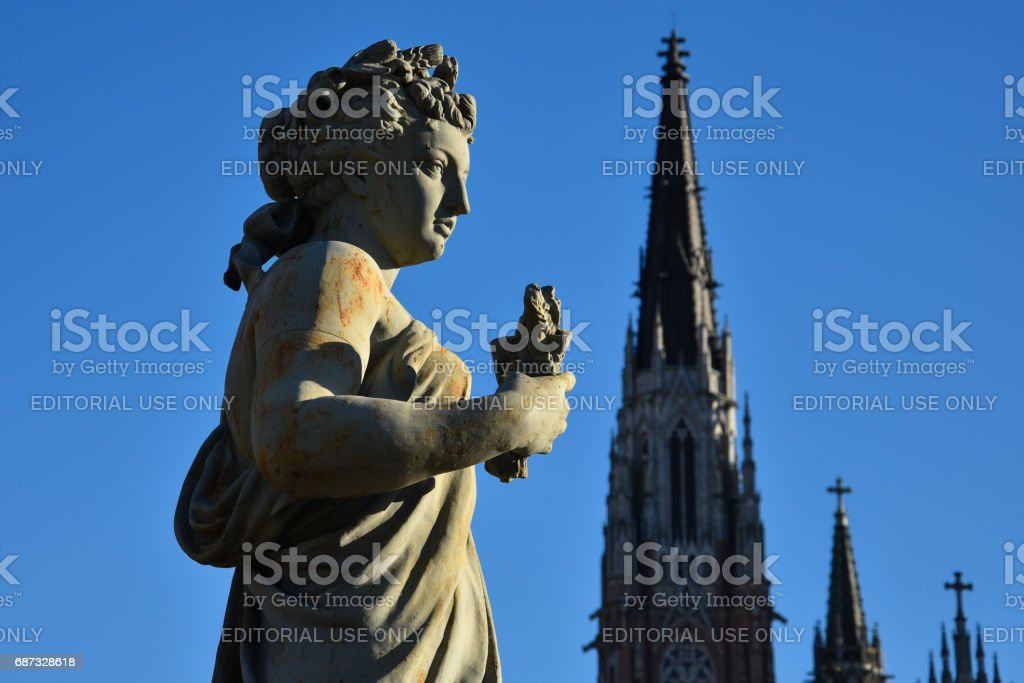 Statue 'El Verano' at Moreno Square with the cathedral on the background stock photo