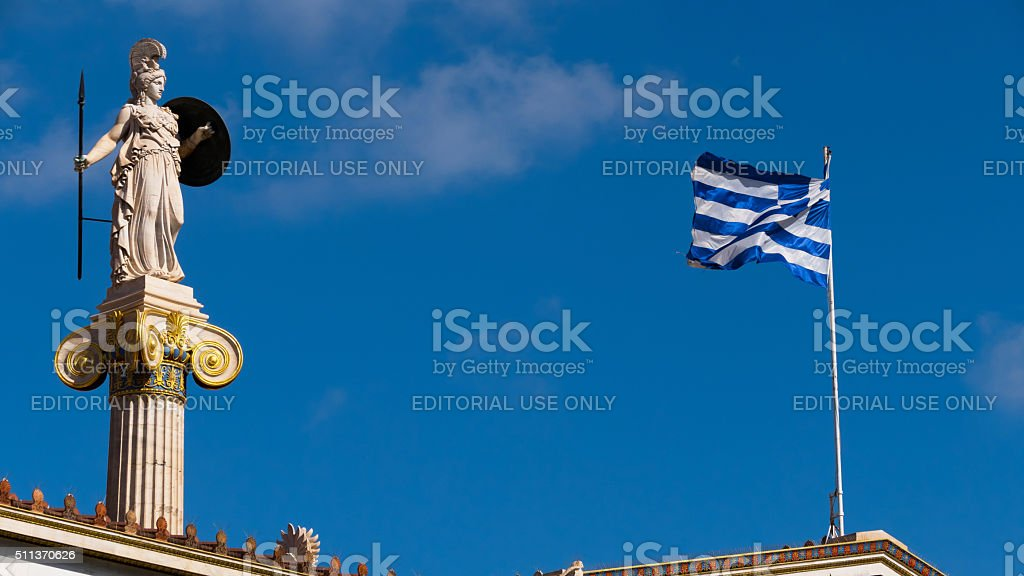 Statue from the Academy in Athens, Greece - with flag stock photo