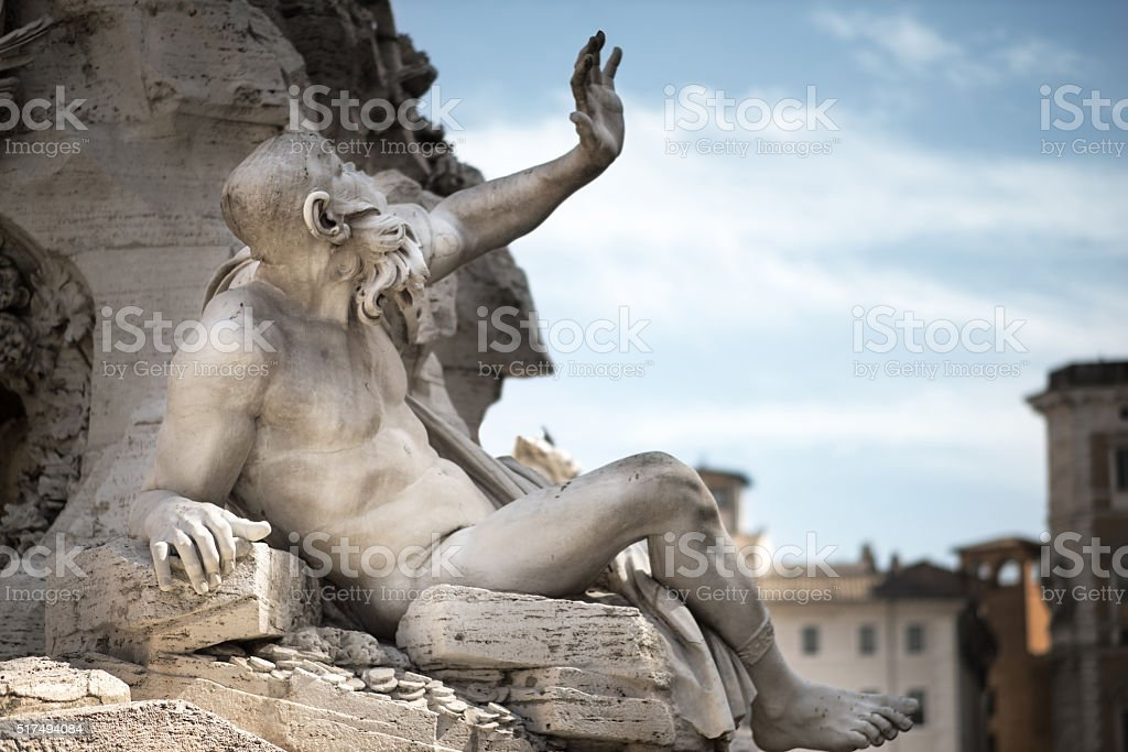 Statue in Fountain, Piazza Navona, Rome, Italy stock photo