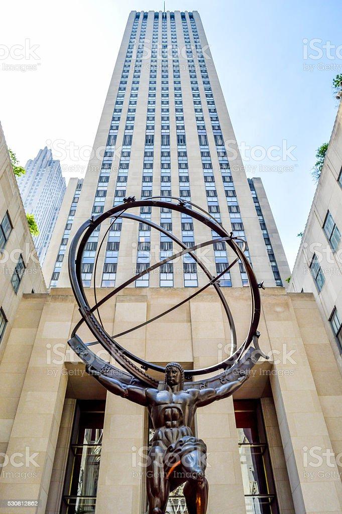 Statue in front of a skyscraper stock photo