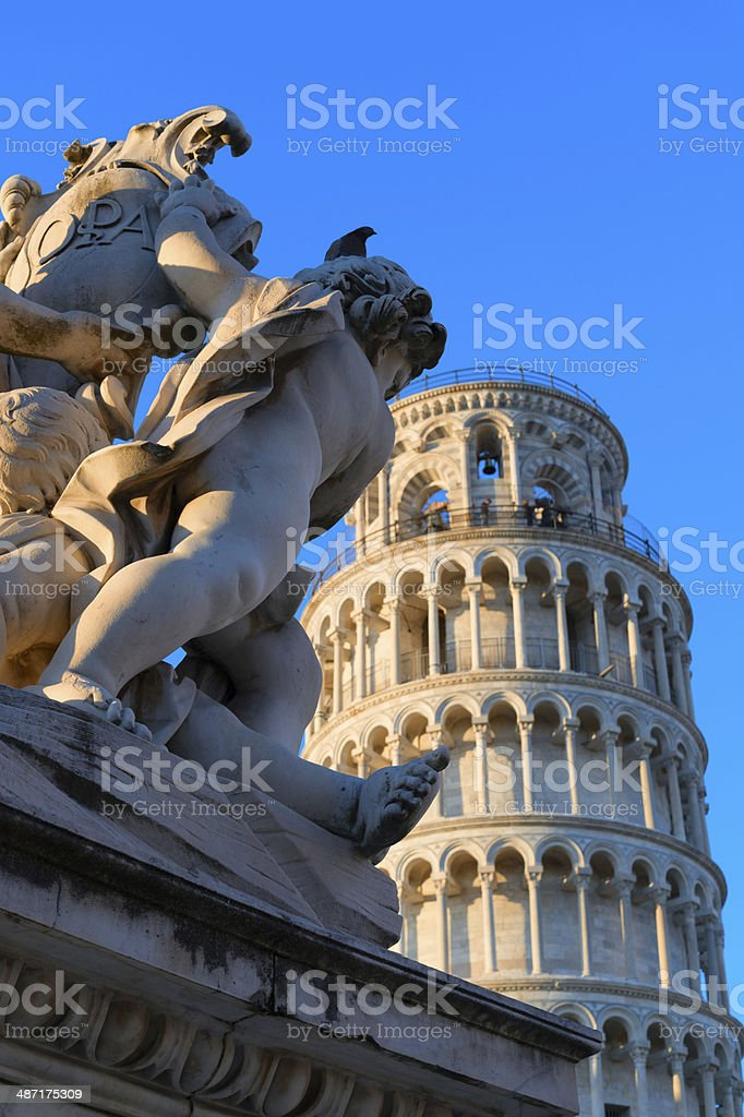 Statue in front of the leaning tower, Pisa stock photo