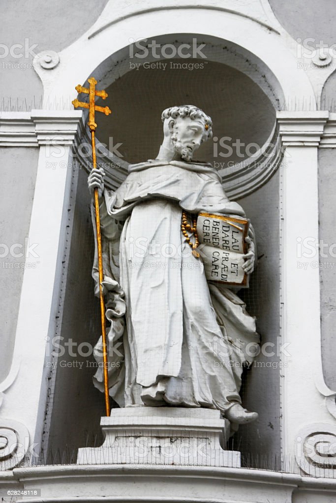 Statue in the exterior niche of St Michael stock photo