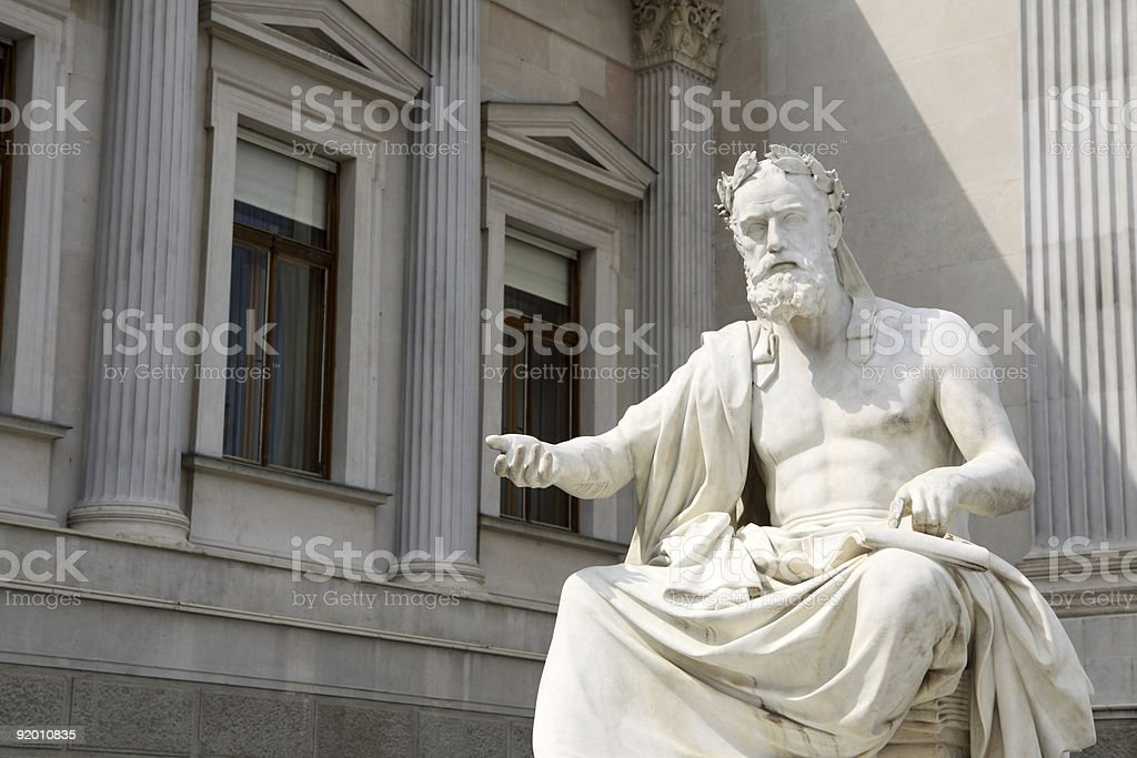 Statue infront of the Austrian Parliament stock photo