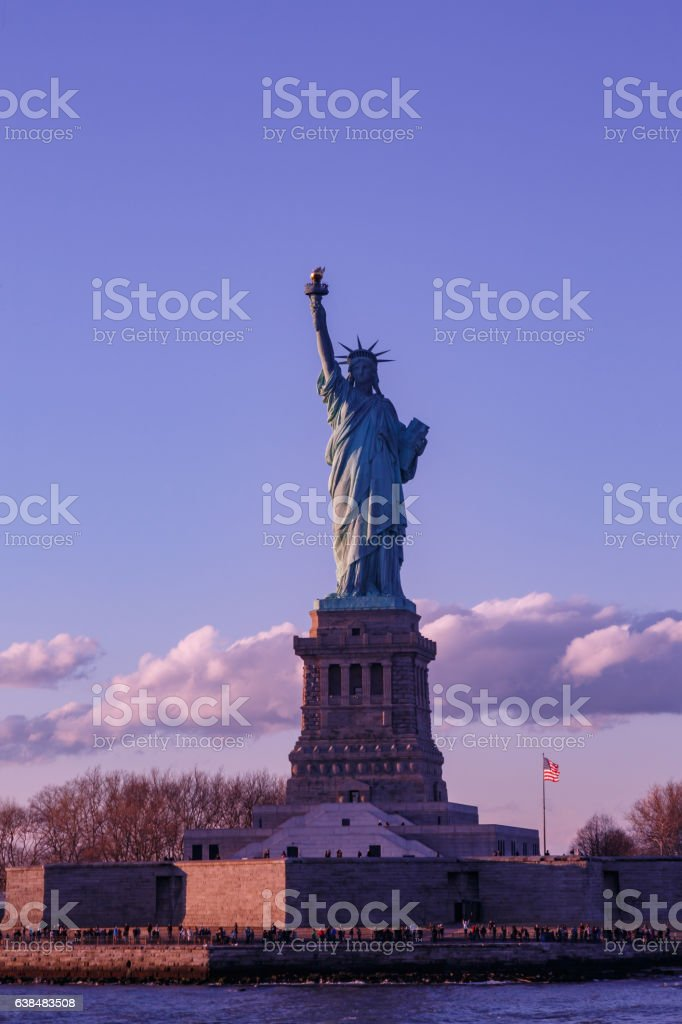 Statue liberty and purple sky. stock photo