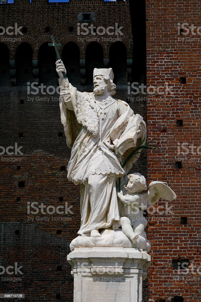 statue of a bishop and an angle stock photo