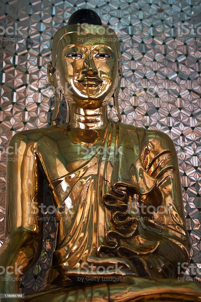 Statue of a gold Buddha royalty-free stock photo