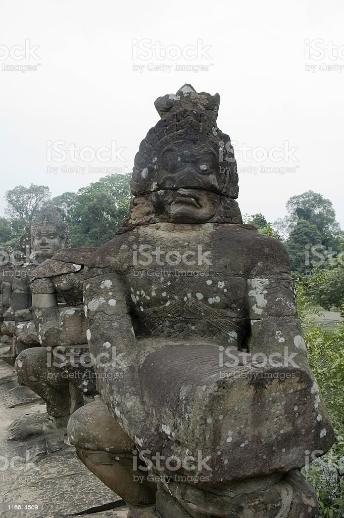 Statue Of A Guard Outside Angkor Thom In Cambodia stock photo