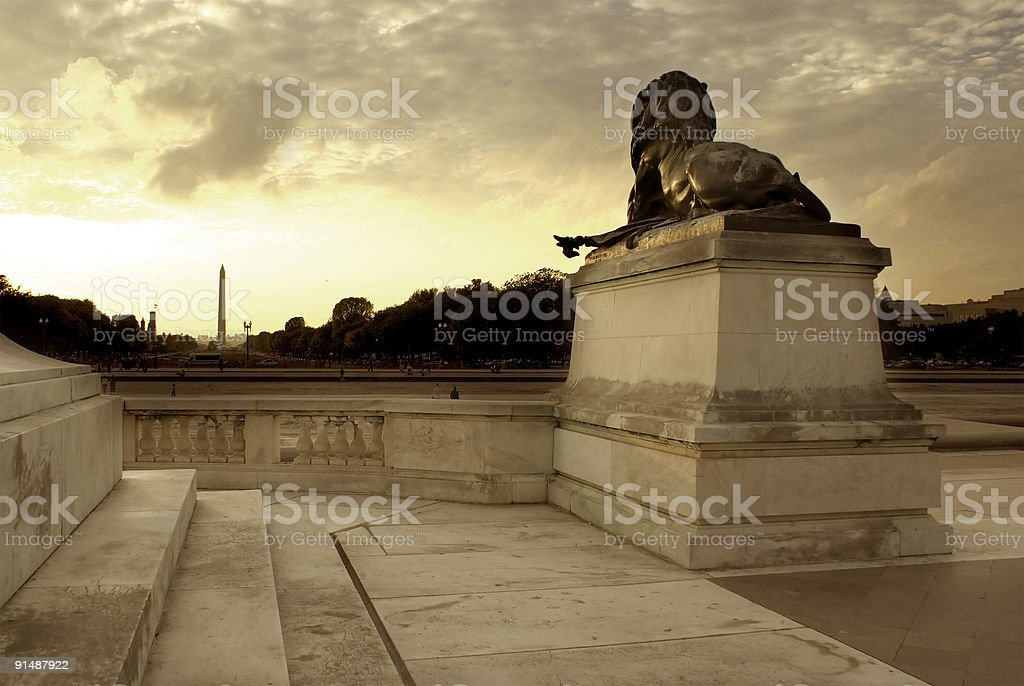 Statue of a Lion with the Washington Monument royalty-free stock photo