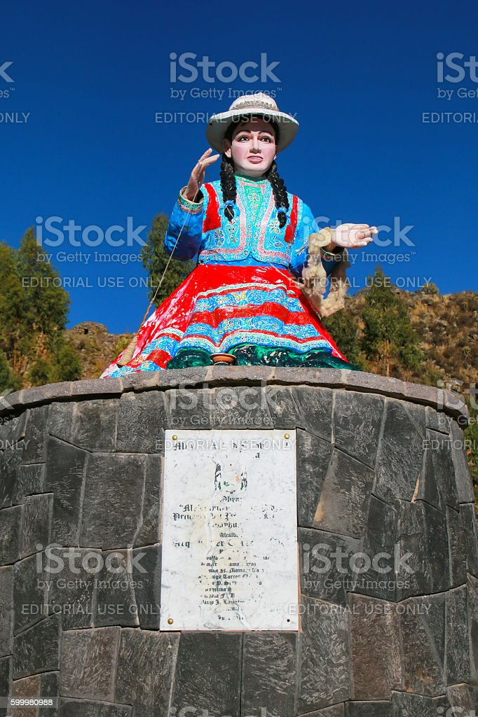 Statue of a local woman spinning wool in Chivay town stock photo