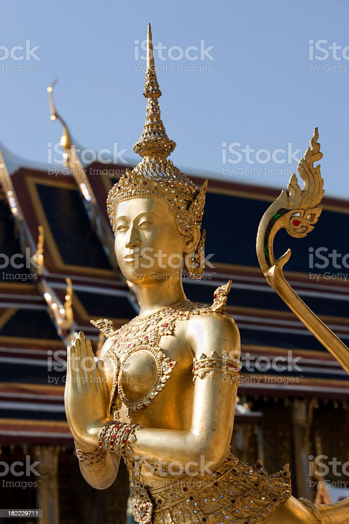Statue of a mythical being, at the Grand Palace, Bangkok. royalty-free stock photo