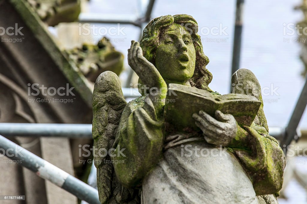 Statue of a singing angel stock photo