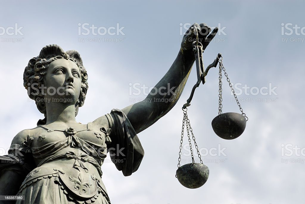 Statue of a woman holding a balance scale stock photo
