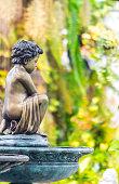 Statue of angel in cozy garden.