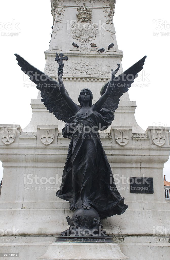 Statue of angel with cross(Portugal) royalty-free stock photo