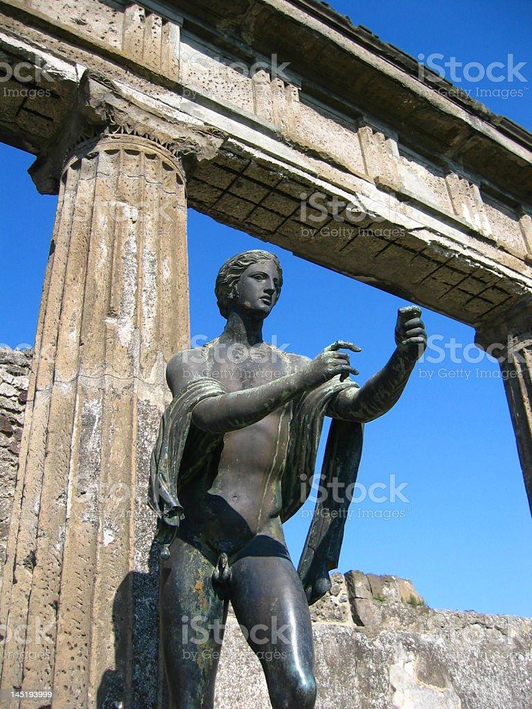 Statue of Apollo next to column and arch stock photo