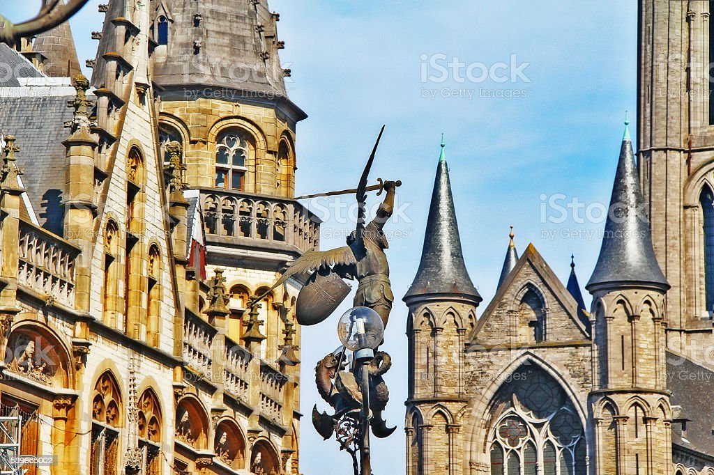 Statue of Archangel Michael slaying Dragon on St. Michael Bridge stock photo