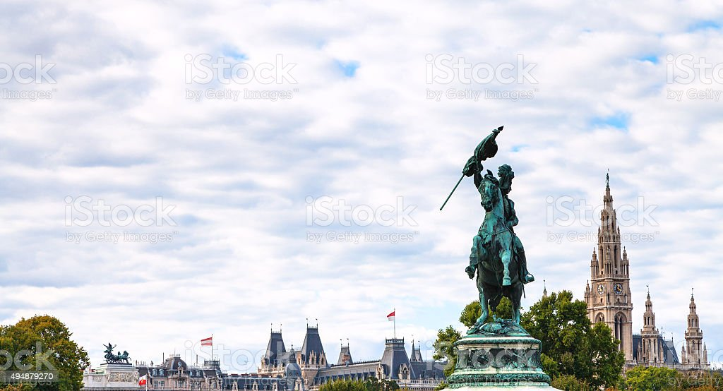 statue of Archduke Charles and towers of Rathaus stock photo
