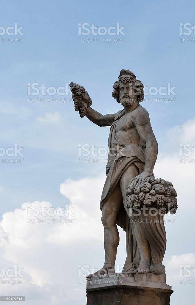 Statue of Autumn, or Bacchus in Holy Trinity Bridge, Florence stock photo