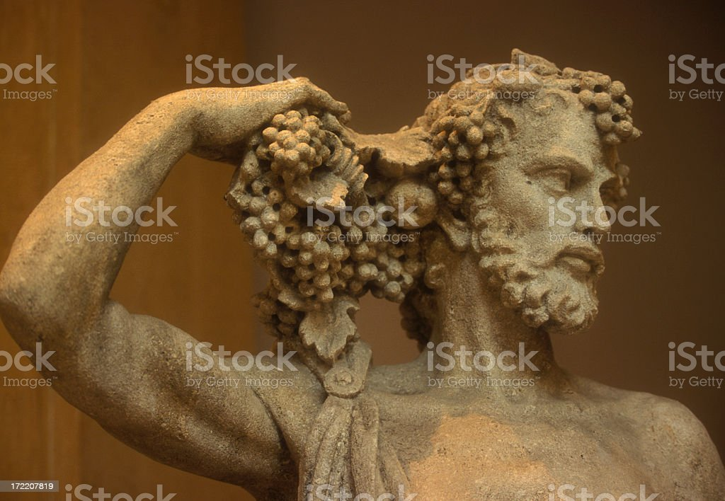 Statue of Bacchus holding his hair stock photo