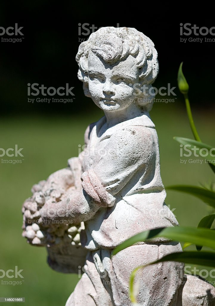 Statue of Boy in a Garden royalty-free stock photo