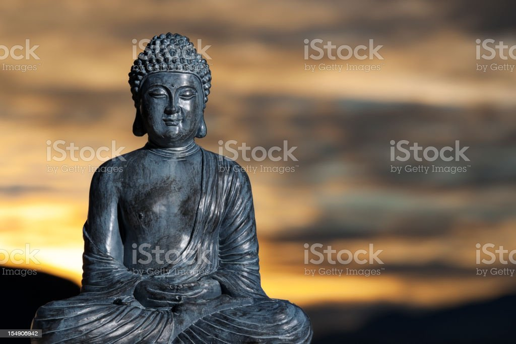 Statue of Buddha against a Japanese sunset royalty-free stock photo