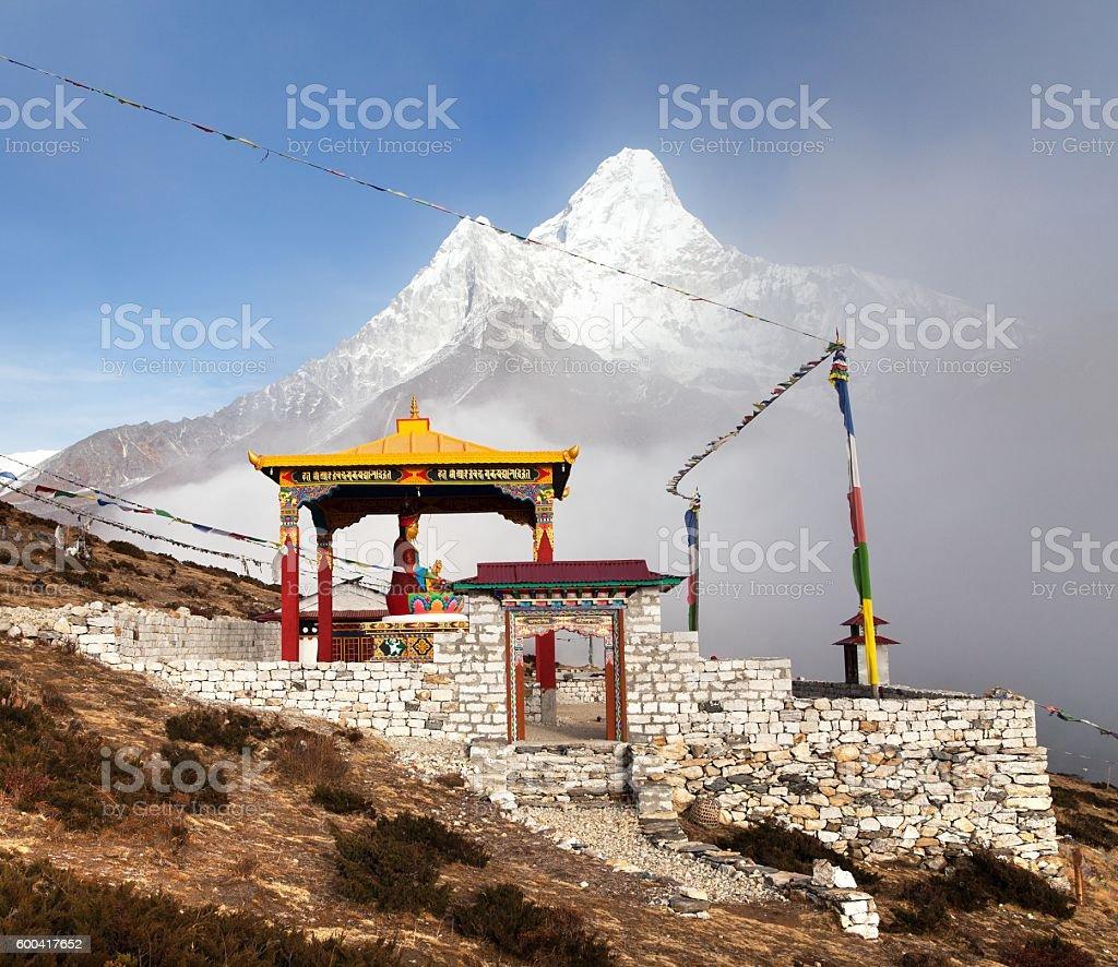 statue of buddha in Pangboche monastery and mount Ama Dablam stock photo