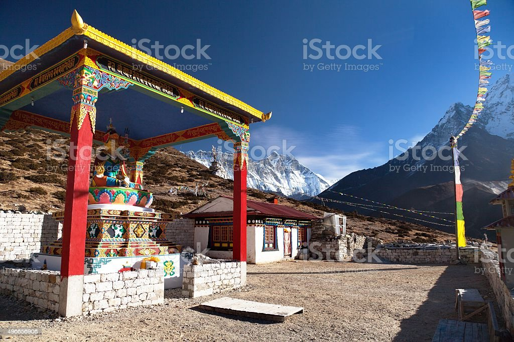 statue of buddha in Pangboche monastery and mount Lhotse stock photo