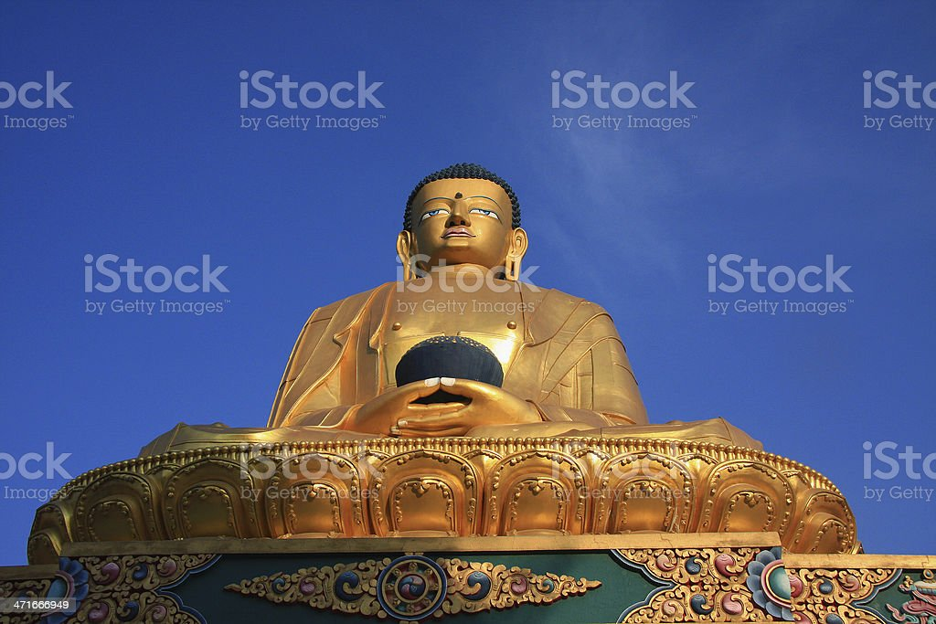 Statue of Buddha in Swayambhu against a clear blue sky. royalty-free stock photo