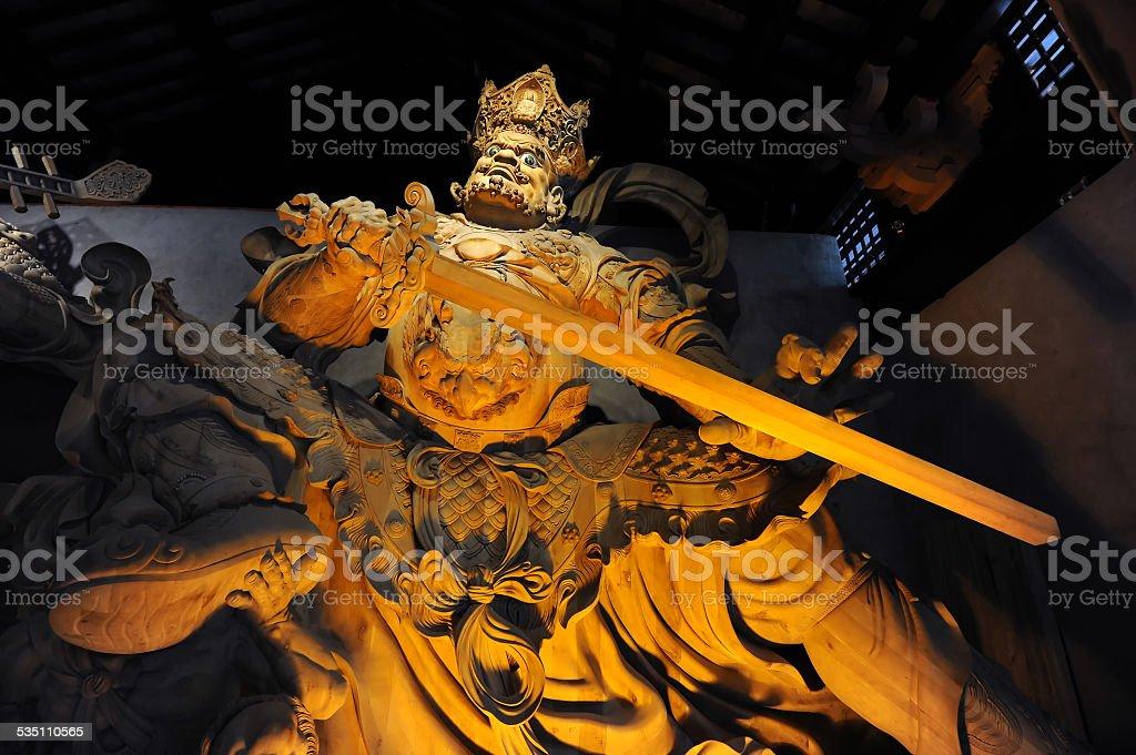 Statue of buddhist deity stock photo