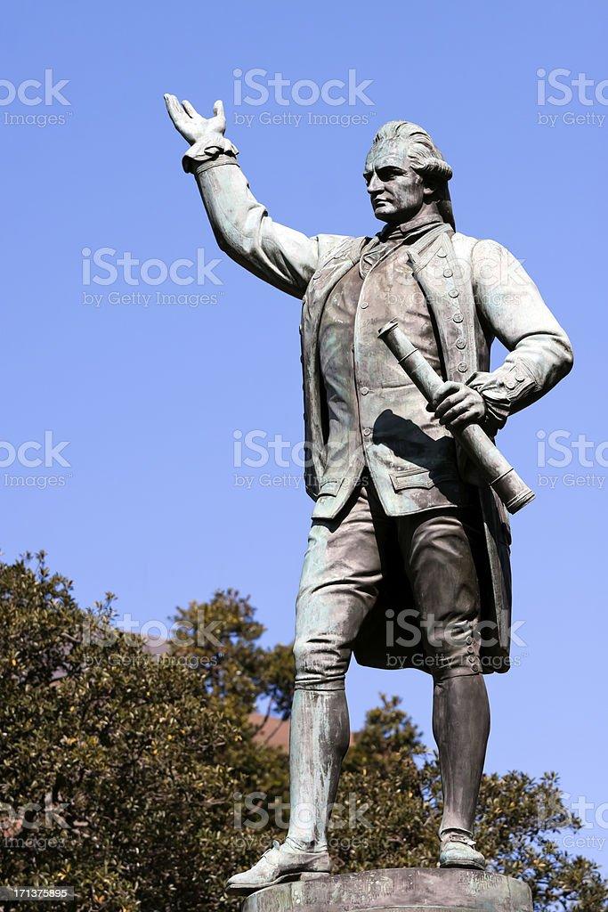 Statue of Captain James Cook against blue sky, copy space stock photo