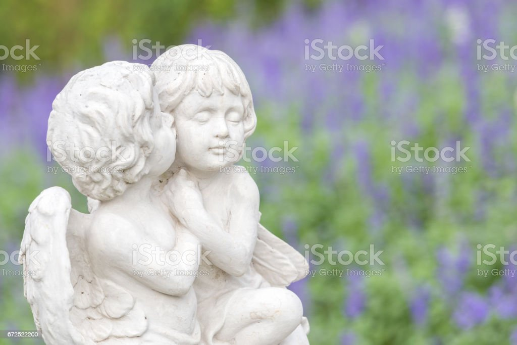 Statue of couple cupid in the garden. stock photo