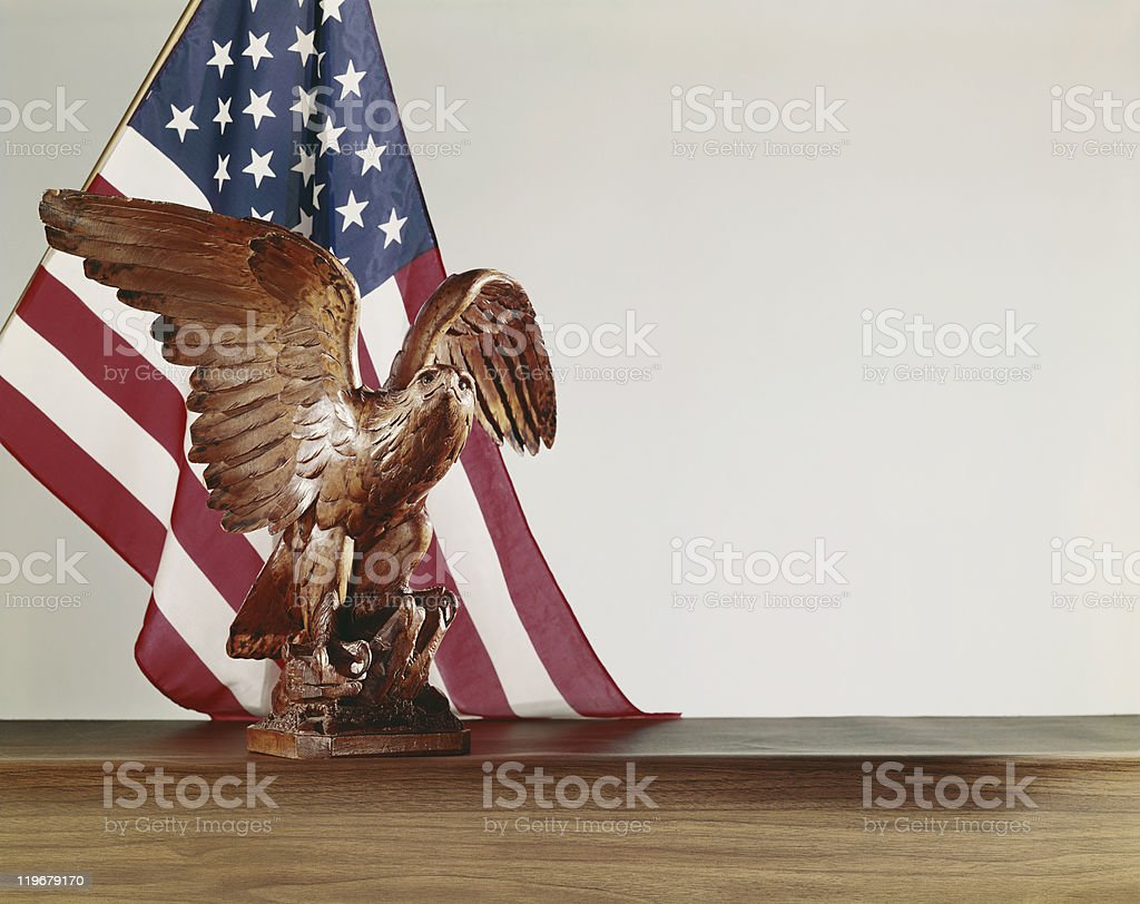Statue of eagle with U.S. flag  royalty-free stock photo