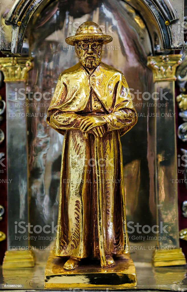 Statue of Father Damien in Mechelen Cathedral stock photo