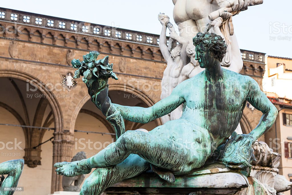 statue of fountain of neptune close up stock photo