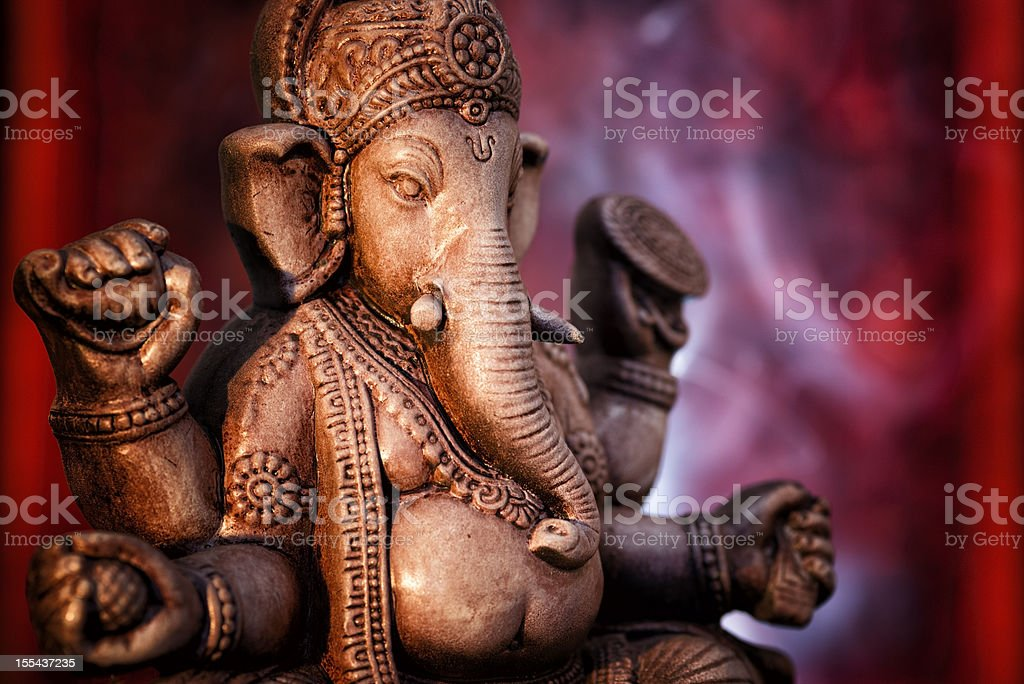 A statue of Ganesha, a deity of India on red background stock photo