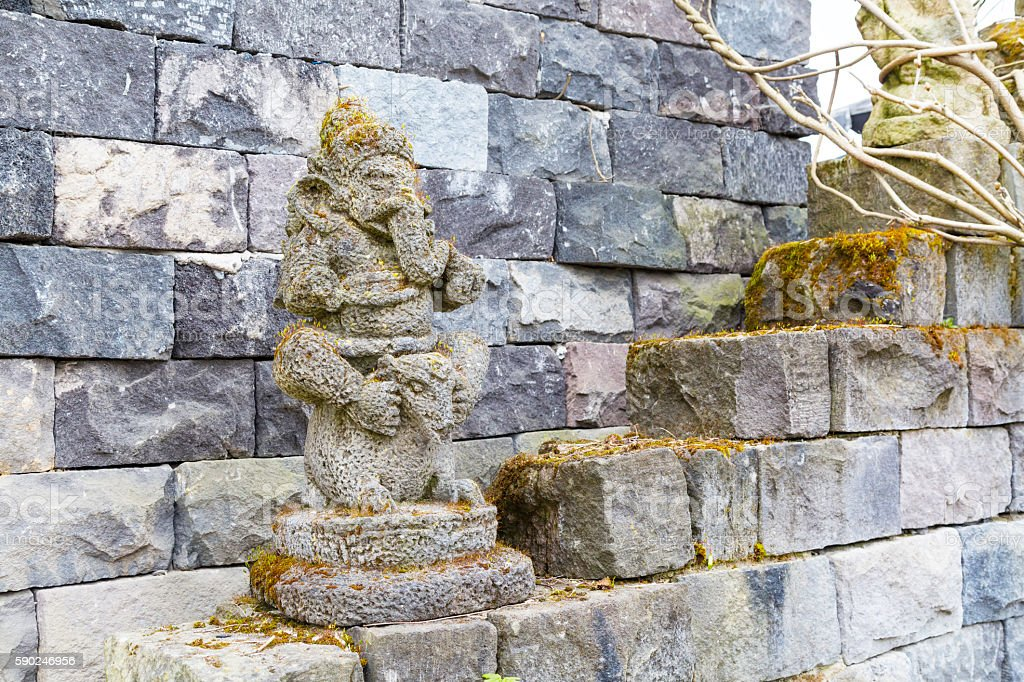 Statue of ganesha and temple wall, Asia stock photo