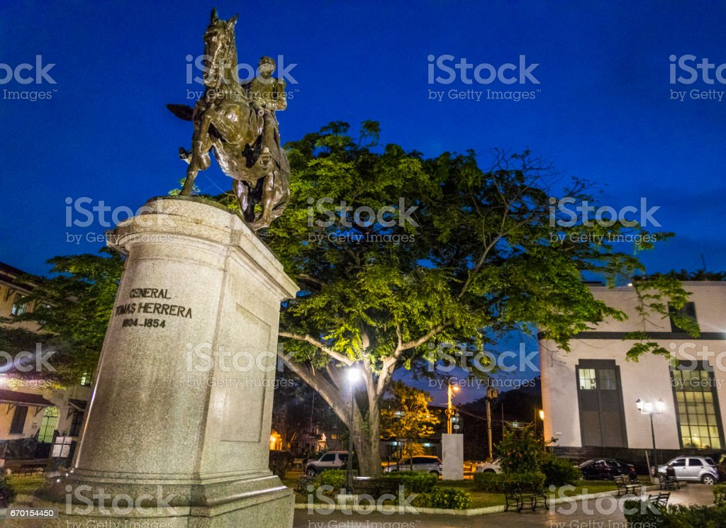 Statue of General Tomas Herrera and some buildings in the background in Casco Viejo , Plaza Tomas Herrera in Casco Viejo, Old Town of Panama City. stock photo